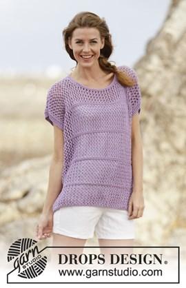 Gebreide mouwloze trui met kantpatroon.