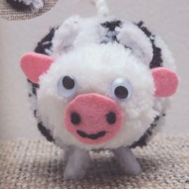 Pompon koe een echte knuffelkont!