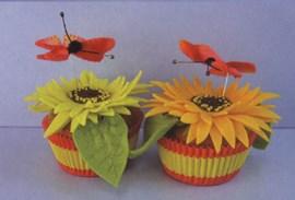 Zonnebloem met vlinder cupcake.