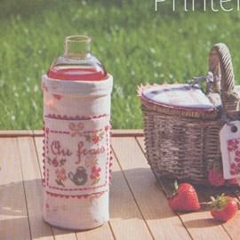 Geborduurd label voor een fles of pot.