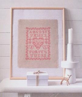 Geborduurd alfabet met hart.