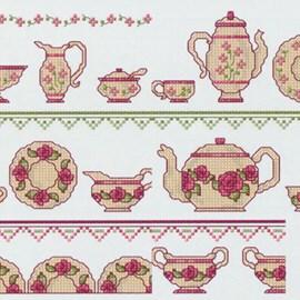 Borduurrand met thee en koffiepotjes.