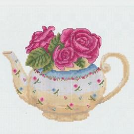 Vrolijke theepot met rozen.