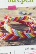 Geknoopt armbandje met regenboog ....